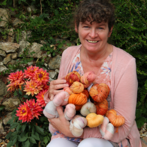 Steph holding yarn in the garden